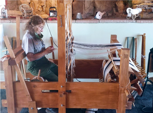 Ranger Jeanne Simonelli warps Big Byrd, the historic loom received from the LBJ Ranch